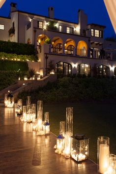Clusters of hurricanes and lanterns full of candles for dramatic, romantic wedding lighting