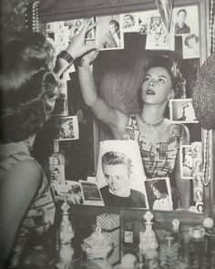 Natalie Wood putting up pictures of James Dean in her dressing room after his death