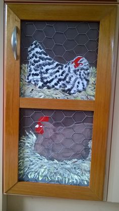 My daughter painted the chickens for me and I overlaid them with chicken wire and framed them with varnished rimu