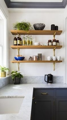 Kitchen space with reclaimed wood shelves