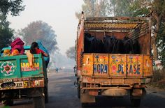 Trucks on the road between Delhi and Agra - Photo by Towards Light