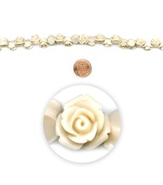 Introducing the newest Strands from Blue Moon Beads! Let your creativity bloom with these carved acrylic rose beads. They are great for stringing but also have a flat back and can be used as cabochons and glued onto collaged projects.      Material: Plastic     Color: White/Cream     Shape: Flower