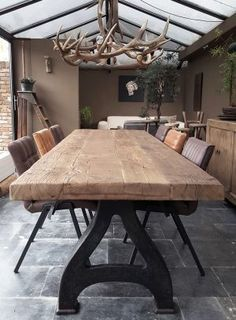Industrial design table with a 8cm reclaimed oak top & old cast iron legs More