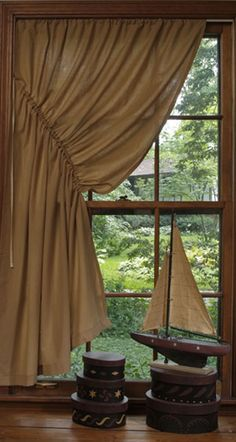 I would love to have this style of curtain, just can't really find out what type of fabric to use! I know how to sew, if you have any idea please advise. Thanks