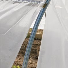 Extruded aluminum channel attaches to high tunnel frames, baseboards, and hipboards. Greenhouse Film, Off Grid Batteries, Cash Crop, Chain Link Fence, Vegetable Garden Design, Extruded Aluminum, Baseboards, Car Cleaning