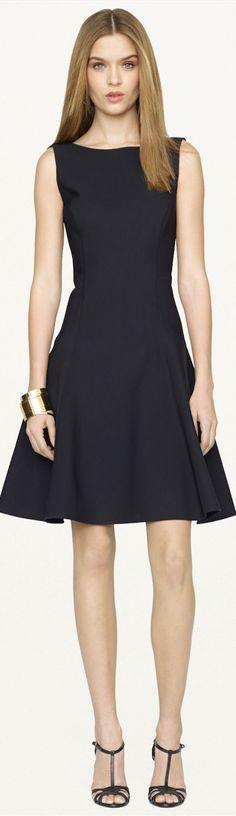 Black Label Neoprene Rayner Dress with ruffled hem and ballet neckline and V-back.