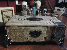 I made this jewelry box out of an old cigar box, mod podge old dictionary pages and added some Tim Holtz fun stuff. Neat!