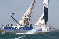 The IMOCA Open 60 yacht 'Artemis Ocean Racing II' plunging through a wave as she heads for the finish line in a strong breeze  during Aberdeen Asset Management Cowes Week #sailboats #boats #sailing