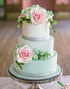54. These edible florals look so yummy and we love the added bling with the sparkly bands. See all there is to love from these dessert table ideas here captured by Angelworx Photography with cake by Sweet Sugarboy Ed.