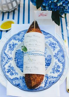Guérard wrapped baguettes—a more literal nod to the French theme—with calligraphed menus, which were printed on vellum and wrapped in coordinating baker's twine. | Lonny.com