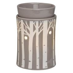 Scentsy Aspen Grove Warmer Bask in the serene glow of soft morning light filtering through a forest of aspen trees on a muted gray base, this is a striking warmer which is magical to view in the evening.