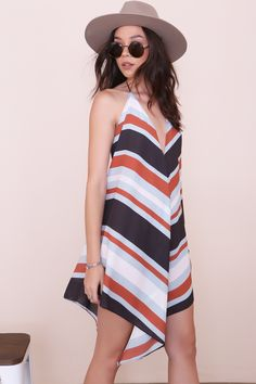 Striped chiffon halter dress. Front and back v-neckline. Beaded tasseled tie closure. Unlined. Style #: 26-500LD Material: Polyester Color: Multi Model is wearing a small