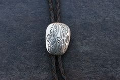 A personal favorite from my Etsy shop https://www.etsy.com/listing/247734136/vintage-navajo-sterling-silver-bolo-tie