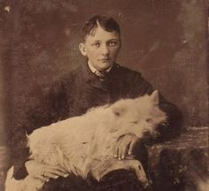 1870s Sad Tin type of a young man holding his beloved dog who has passed away.