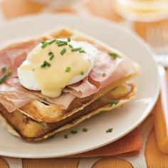 Waffles Benedict | Can't decide between waffles or eggs for breakfast? Have both! Try our Waffles Benedict—a combination of fluffy buttermilk waffles and rich and gooey eggs Benedict. | SouthernLiving.com