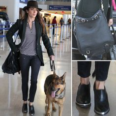 a dark green Rachel Zoe riding coat with AG Adriano Goldschmied ankle-zip denim while arriving at LAX airport. The actress layered her jacket over a striped Pencey tee, then topped her travel look with black Western ankle boots, a black CC Skye messenger bag.