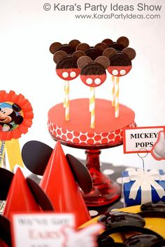 link to Kara's Party Ideas Show on My Craft Channel: Mickey Mouse party episode, including tutorials for these Mickey Oreo pops, a party wreath and Mickey Mouse hanging lanterns