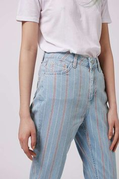 Do transitional style in our MOTO high rise Mom jeans featuring a pastel stripe detailing and rolled hems. We're wearing ours with metallic block heeled shoes. #Topshop
