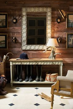 In this practical yet inviting boot room by OKA, the distressed gold picture frames and faux antlers raise a glass to the Scottish theme. The white wooden cabinet and rattan baskets add storage. Dark Wood Bedroom, Hotel Lounge, Function Room, Entry Way Design, Wooden Cabinets, Home Accessories, Family Room, Interior Design, Interior Ideas