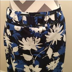 HPBlue Floral Skirt So cute!! Zips up the side. Blue and white flower design. The waist has a faux belt on front (see picture) Skirt is lined. Shell is 98% cotton/2% spandex. Lining is 100% polyester. 20 1/2 in long. Hips 18 in. Waist 16 in. The skirt is a dark navy background. Looks perfect with the Cato blouse listed in my closet!Host Pick Girly Girl @knashaycheck out her awesome closet!! Rafaella Skirts Pencil
