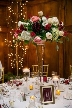 These stunning tall centerpieces stood in a golden room with wood detailing. Get more real wedding inspiration and wedding planning tips on our website now! Wedding Reception Centerpieces, Wedding Flower Arrangements, Flower Centerpieces, Wedding Bouquets, Wedding Flowers, Wedding Decorations, Flower Bouquets, Centerpiece Ideas, Purple Wedding