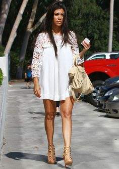 8e8cba1509d5 Fashion Spotlight  Kourtney Kardashian Kourtney keeps her cool on a  sweltering summer day in this white mini dress by H M