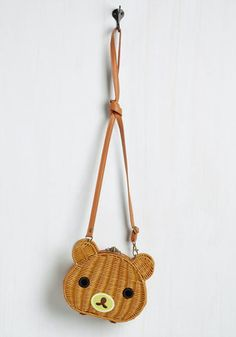 Theres always something to celebrate when this adorable bag is in tow, so 'kawaii' not carry it everywhere! This satchel's light brown wicker and bear visage - complete with glossy eyes and a yellow snout - is so cute it warrants a round of a-paws!