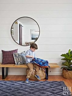 boy sitting on entryway bench