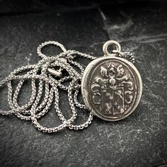 This beautiful men's pendant design features a wax seal stamped charm that was created from an original antique seal and is like wearing a piece of history every time you put it on.   Handcrafted in the USA.  The necklace is available in 20 or 24 inches in length and looks great in an open collared shirt or over a t-shirt. Handmade Accessories, Jewelry Accessories, Jewelry Shop, Jewelry Making, Vintage Gentleman, Wax Seal Stamp, Pendant Design, Needle Felted Animals, Wax Seals