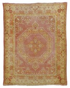 USHAK CARPET WEST ANATOLIA, EARLY 20TH CENTURY Approximately 12 ft. 6 in. x 9 ft. 10 in. (381 cm. x 300 cm.)