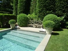 with gravel seating areas, benches and pots at either end, the pool is as decorative as it is functional