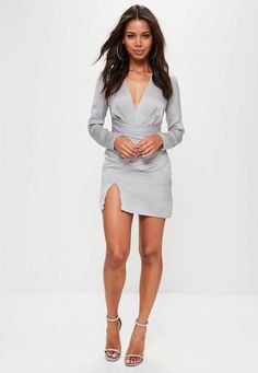 Slay all day every day wearing this silky dress - featuring long sleeves, v neck and silver undertones. Pack a punch!