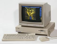 Commodore Amiga 1000 personal computer with 1081 RGB monitor running Electronic Arts Deluxe Paint. The Amiga 1000 (1985) was the first model released. Original photo by Kaiiv (de.wikipedia), editing by Pixel8.