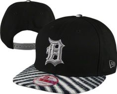 Detroit Tigers 9Fifty Zubaz Basic Snapback Adjustable Hat by New Era. $26.99. Adjustable back closure. Officially licensed. Six panel design construction. Team design. You have your Detroit Tigers look down pat, now all you need is to top it off with this Detroit Tigers 9Fifty Zubaz Basic Snapback Adjustable Hat. This stylish hat is the ultimate to show off your undying admiration for the Tigers. Features vibrant team graphics and is adjustable for your desired comfort.