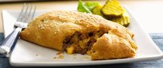 Enjoy these cheeseburger hand pies made with beef and Pillsbury® Big & Flaky dinner rolls – a delicious dinner!