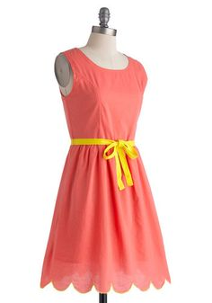 This color is so attention-grabbing! The material looks well-fitting yet also soft and a bit flowy. The rounded bottom bit at the hem of the dress adds an extra little detail along with the pop of color in the yellow belt. Darling choice for a day out with friends.
