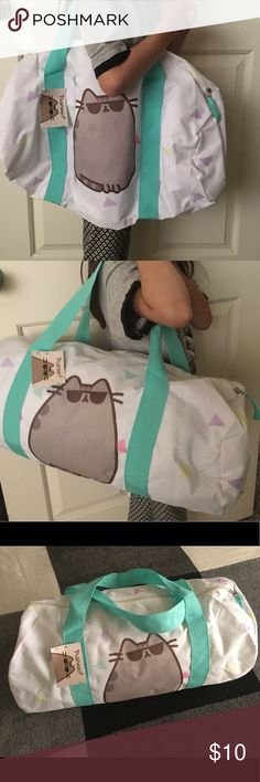 Pusheen Cat duffle New with tags. Cute Pusheen the Cat duffle. Great for travel. Small black mark on corner, see picture 😺 Pusheen the Cat Bags Totes