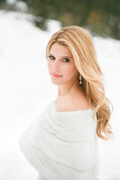 Winter Bride in Mink Shawl | Photography: Aaron Delesie Photographer. Read More: http://www.insideweddings.com/weddings/snowy-spring-celebration-in-aspen-colorado/596/