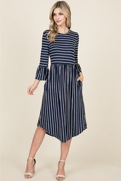 3452d28a2f6 he Sonia Striped Dress With Bell Sleeves   Pockets features 3 4 bell sleeves