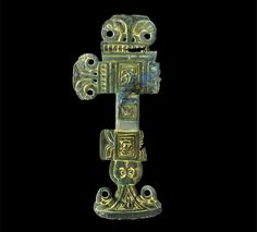 Anglo-Saxon 'florid' cruciform brooch pinned from an auction website, now in a private collection. Gilded and silvered copper-alloy, with its right-hand head-plate knob missing. Allegedly found at Saxthorpe in Norfolk. 6th century AD.