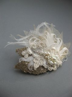 Wedding fascinator bridal hair accessory headpiece Natural burlap  Nude Ivory leaves lace feather pearl tulle netting. $46.00, via Etsy.