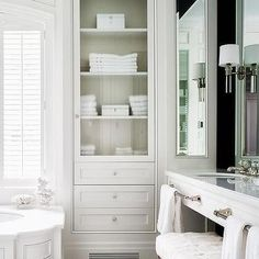 Wainscoted Tub with Glass Door Inset Linen Cabinet