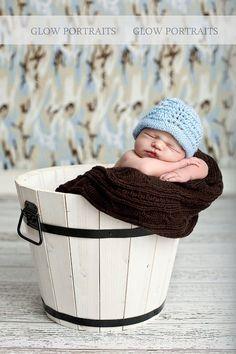 Baby in a bucket.  LOVE sleeping babies!