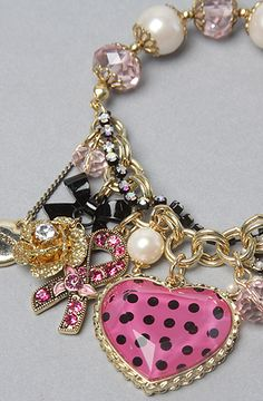 girly girl charm bracelet with pink, black and gold