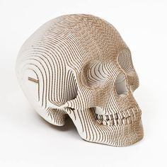 It's officially Autumn, time to spice up your home decor! Check out the awesome cardboard skulls at The Green Gypsie. They make a killer coffee table accessory.
