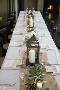 Neutral, elegant wedding reception table setting idea - burlap table runners adorned with greenery and candle lanterns {Abby Hacker Photography}