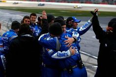 HAMPTON, GA - MARCH 01: Crew members of Jimmie Johnson, driver of the #48 Lowe's Chevrolet, celebrate after winning the NASCAR Sprint Cup Series Folds of Honor QuikTrip 500 at Atlanta Motor Speedway on March 1, 2015 in Hampton, Georgia. (Photo by Jerry Markland/Getty Images)
