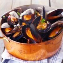 Photo about Copper pot of gourmet mussels served on a napkin garnished with fresh herbs for a tasty seafood meal. Image of lunch, mussels, cuisine - 31589464 Clams Seafood, Fresh Seafood, Mussels White Wine, Seafood Recipes, Cooking Recipes, Easy Weekday Meals, Dinner Party Menu, Happy Kitchen, Gourmet