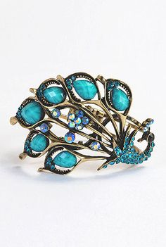 Peacock hinged bracelet  STYLE # CL0023307  $19.95  Color: Dull gold/turquoise