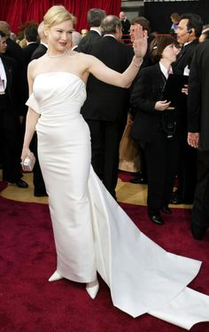 """Oscars 2004 - Renee Zellweger WON the Oscar for Best Supporting Actress for her role in """"Cold Mountain.""""  She wore a crisp white silk draped-bodice designed dress by Carolina Herrera.  She also wore a $550,000 vintage Cartier diamond necklace, a matching diamond bracelet, and ring,"""